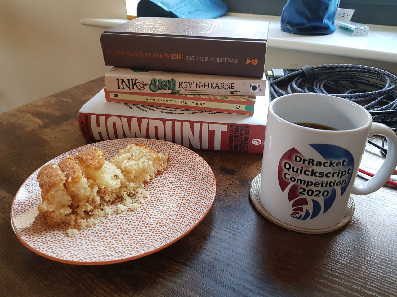A good way to start the day: coffee, cake, and books.
